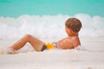 Boy playing in sea