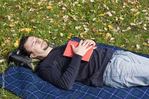 Young Adult Relaxing in the Park during a Weekend Afternoon