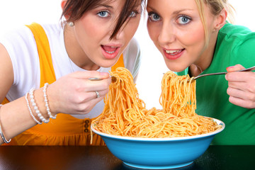 Young Women Eating Spaghetti. Model Released