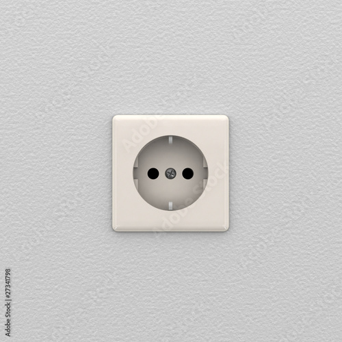 Electrical outlet on white wall