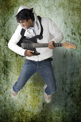 Dancing guitar player on grunge background