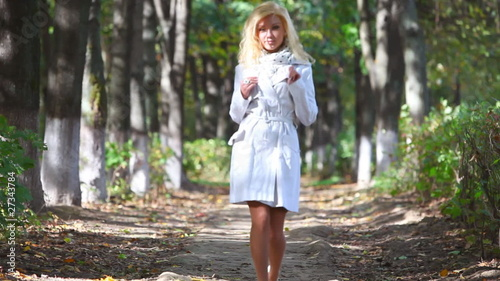 Young woman walking in park. Two versions sequentially.