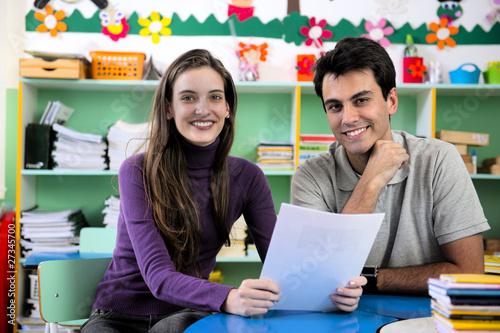 Leinwanddruck Bild Teacher and parent in classroom