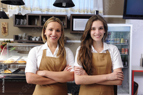 Waitresses working at a cafe