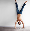 Handstand - Crazy man listening to music on headphones