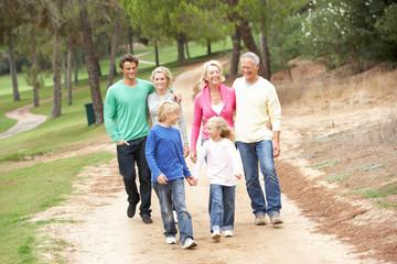 Three Generation Family enjoying walk in park
