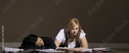Two Women Studying And Sleeping