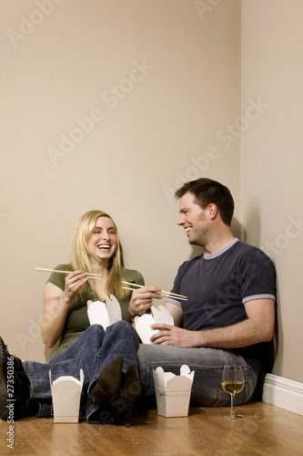 Couple Eating On The Floor