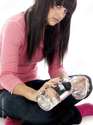 Young Woman Drinking Vodka. Model Released