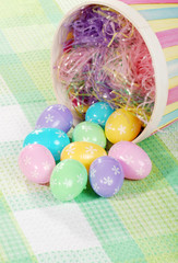 closeup spilled easter eggs and colorful basket