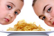 Children with Bowl of Crisps.Models Released