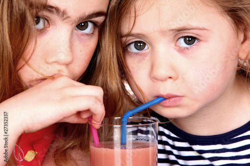 Sisters Drinking Fruit Smoothie. Models Released