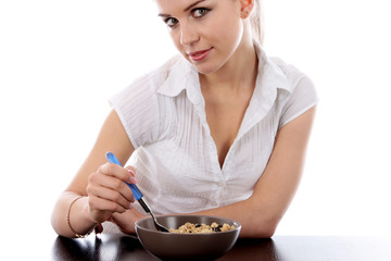 Young Woman Eating Granola Cereal. Model Released