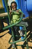 A Young Boy Climbing On Playground Equipment - Fine Art prints