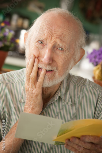 Senior man with sympathy card