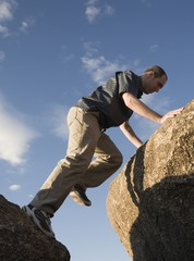 Man Climbing Up Rocks