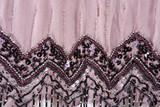 Detail of fabric decorated with rhinestone and beads poster