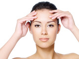Woman touching her forehead without wrinkle poster