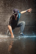 Cool looking hip-hop dancer in aqua studio