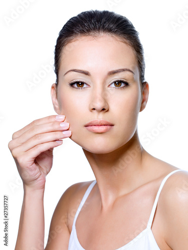 Woman pinching skin on her cheek - isolated