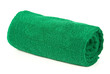 Green rolled up towel over white