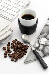 Espresso in small cup with coffee beans