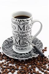 Coffee mug with burned coffee beans