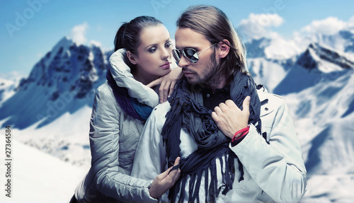 Handsome couple having fun on winter holidays