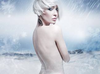 Beauty blonde in the winter scenery