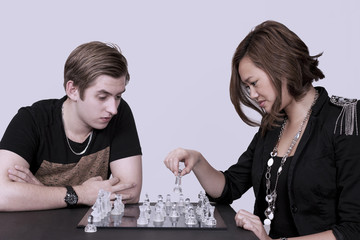 Chess players, young woman makes her move