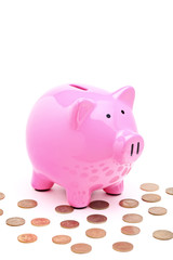 A view of a pink piggy bank and many coins
