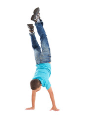 young boy doing a handstand