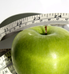 Healthy Organic Apple With Measuring Tape