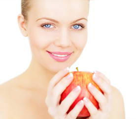 Beautiful girl holding a red apple isolated on white background