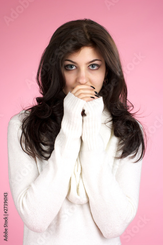 Young woman with white sweater