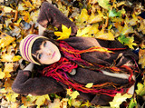 Girl in autumn leaves.