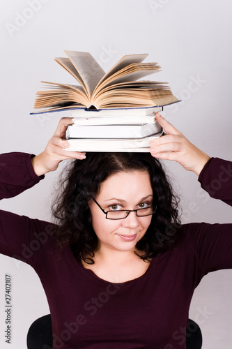 attractive woman with stack of books