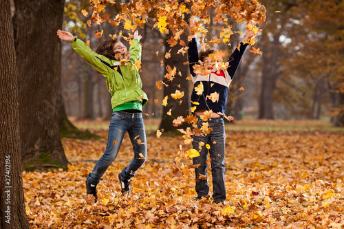 Kids jumping in autumn park
