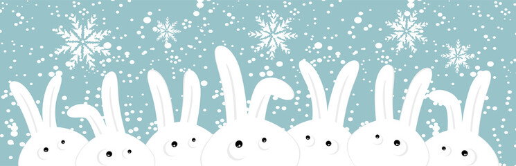 Rabbits on christmas winter background