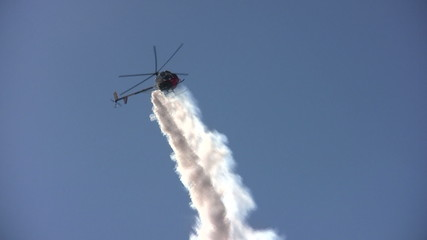 Helicopter performing aerial stunt