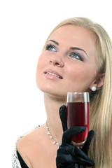 Blond in a dress drink wine