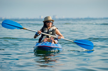 woman kayaking in a tropical sea