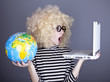 Funny girl in glasses keeping notebook and globe.