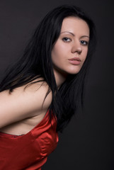 Portrait of a young brunette posing
