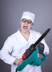 Crazy doctor with portable saw.