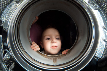 boy peer into get old washer