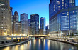 Chicago skyline along the river just after sunset