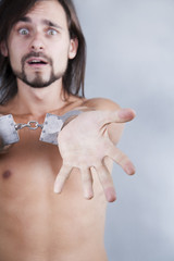 chained in handcuffs long-haired caucasian guy