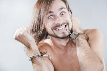 The guy has broken off his handcuffs
