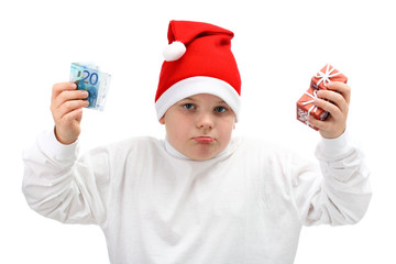 Boy in Santa hat holding Christmas presents and money isolated